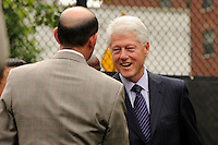 Former President Bill Clinton shakes hands with MLS Commissioner Don Garber prior to a press conference announcing former President Bill Clinton as the honorary chairman of the USA Bid Committee to host the FIFIA World Cup in 2018 or 2022 at the FC Harlem Field in Harlem, NY, on May 17, 2010.