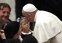 Papa Francesco bacia una bambina al termine dell'udienza Generale del mercoledi' in aula Paolo VI in Vaticano, 16 gennaio 2019.<br /> Pope Francis kisses a child at the end of his weekly general audience in Paul VI Hall at the Vatican, on January 16, 2019.<br /> UPDATE IMAGES PRESS/Isabella Bonotto<br /> <br /> STRICTLY ONLY FOR EDITORIAL USE