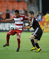FC Dallas forward David Ferreira (10) shields the ball against DC United defender Devon McTavish (18).  FC. Dallas defeated DC United 3-1 at RFK Stadium, Saturday August 14, 2010.