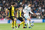 Cristiano Ronaldo of Real Madrid (R) fights for the ball with Borussia Dortmund Midfielder Nuri Sahin (C) during the Europe Champions League 2017-18 match between Real Madrid and Borussia Dortmund at Santiago Bernabeu Stadium on 06 December 2017 in Madrid Spain. Photo by Diego Gonzalez / Power Sport Images