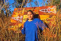Thala Wallis, Western Cape Artist, with artwork, near Weipa, Cape York Peninsula.