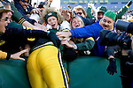 Quarterback Brett Favre #4 of the Green Bay Packers does the Lambeau Leap after rushing for a touchdown during an NFL football game against the Arizona Cardinals at Lambeau Field on October 29, 2006 in Green Bay, Wisconsin. The Packers beat the Cardinals 31-14. (Photo by David Stluka)