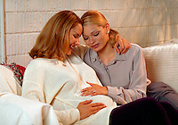 Pregnant Latina woman with friend