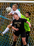 THOMASTON,  CT-101619JS09- Thomaston's John Reeser (25) tries to get a header past Terryville's Colby Rheault (13) and goal keeper Denis Bardi during their Berkshire League match up Wednesday at Nystrom Park in Thomaston.<br /> Jim Shannon Republican-American