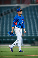 AZL Cubs 2 relief pitcher Chi-Feng Lee (34) walks off the field between innings of an Arizona League game against the AZL Reds on July 23, 2019 at Sloan Park in Mesa, Arizona. AZL Cubs 2 defeated the AZL Reds 5-3. (Zachary Lucy/Four Seam Images)