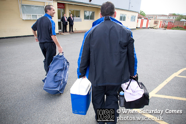 Bangor City 0 FC Honka 1, 23/07/2009. Racecourse Ground, Europa League. Bangor City's physio and kit man carrying equipment into Wrexham's Racecourse Ground, the venue for their sides Europa League second round second leg tie against FC Honka from Finland. The match had to be staged away from City's Farrar Road ground as it did not meet UEFA's stadium standards. The Finns won 1-0 in Wales to go through 3-0 on aggregate in front of 602 spectators in the first season of the newly-introduced competition which replaced the UEFA Cup. Photo by Colin McPherson.