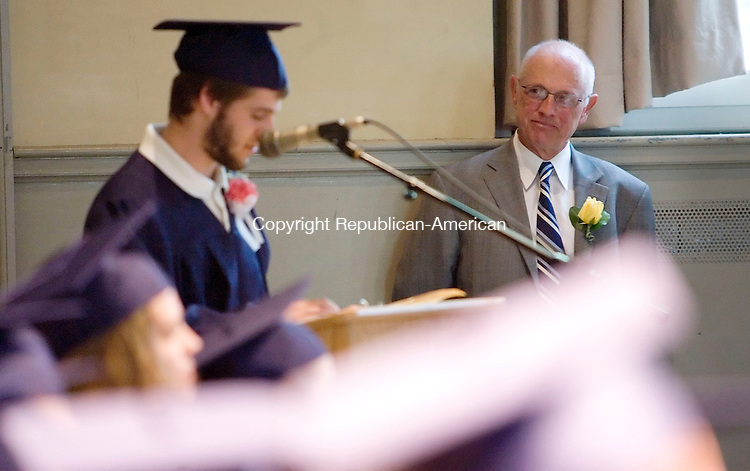 FALLS VILLAGE, CT- 22 MAY 2008- 052208JT07- <br /> Frank Ruotolo, Foothills site coordinator for Region One, listens as Wesley Bousquet, a graduate of the Foothills Adult and Continuing Education Program, speaks during commencement exercises on Thursday at Housatonic Valley Regional High School in Falls Village. Ruotolo is retiring after this school year after working in adult education since 1974.<br /> Josalee Thrift / Republican-American