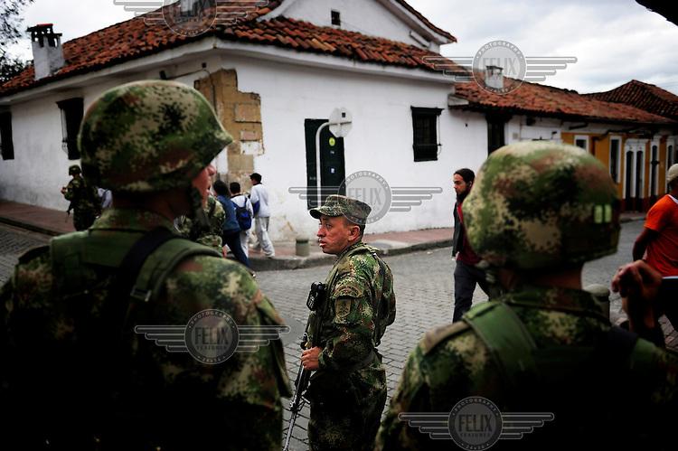 An army patrol through the city centre.