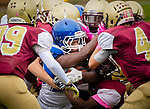 WATERBURY,  CT-101219JS23- Crosby's Edric Guzman (26) gets wrapped up by a host of Sacred Heart-Kaynor players while trying to run up the middle during their game Saturday at Municipal Stadium in Waterbury.<br /> Jim Shannon Republican-American