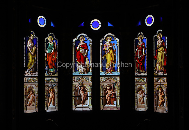 Stained glass windows of saints, in the Oratory, the private chapel of Catherine de Medici, adjoining the Chambre de la Reine or Queen's Bedroom, decorated in 16th century Renaissance style and restored by Felix Duban, on the first floor of the Francois I wing, built early 16th century in Italian Renaissance style, at the Chateau Royal de Blois, built 13th - 17th century in Blois in the Loire Valley, Loir-et-Cher, Centre, France. The chateau has 564 rooms and 75 staircases and is listed as a historic monument and UNESCO World Heritage Site. Picture by Manuel Cohen