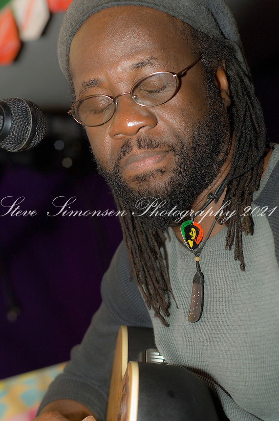 Quito Rymer, owner of Quito's performing on stage at Quito's in Cane Garden Bay, Tortola, BVI