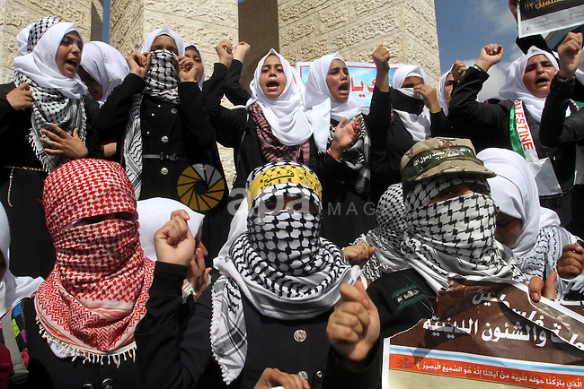 Palestinian schoolgirls shout slogans during an anti-Israel protest in the southern Gaza Strip town of Rafah on October 14, 2015. Amid violent protests and a wave of stabbings spreading fear in Israel and warnings that a full-scale uprising could erupt, a new generation of Palestinians has been leading the unrest. Photo by Abed Rahim Khatib