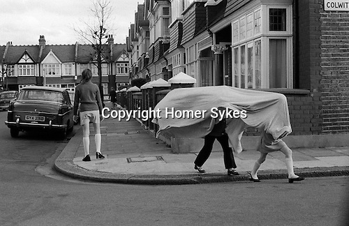 Children playing with bedsheets in the street. Wandsworth SW London UK./<br />