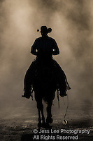 Cowboy in the dust photography