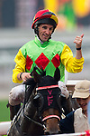 HONG KONG - MAY 04: Neil Callan of Ireland riding Reborn To Win celebrates after winning the Wan Chai Plate at Sha Tin racecourse on May 4, 2014 in Hong Kong, Hong Kong.  Photo by Aitor Alcalde / Power Sport Images