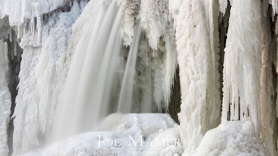 Ice formation and flowing water at Minneopa Falls in Mankato, MN.