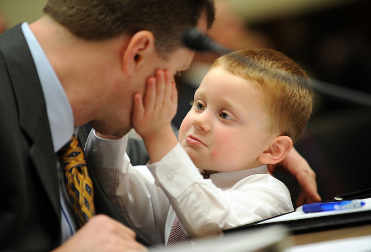 Jacob Hurley, 3, waits for his father Peter to testify during a House Energy and Commerce subcommittee hearing, about how Jacob had diarrhea for 11 days after acquiring salmonella from contaminated peanut butter crackers associated with peanut butter from the Peanut Corporation of America, February 11, 2009.