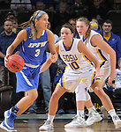 SIOUX FALLS, SD - MARCH 5:  Courtney Ogle #3 of Fort Wayne drives against Kerri Young #10 and Clarissa Ober #21 of South Dakota State in the 2016 Summit League Tournament. (Photo by Dick Carlson/Inertia)
