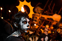A Salvadoran boy with skull face paint takes part in the La Calabiuza parade at the Day of the Dead celebration in Tonacatepeque, El Salvador, 1 November 2016. The festival, known as La Calabiuza since the 90s of the last century, joins Salvador's pre-Hispanic heritage and the mythological figures (La Sihuanaba, El Cipitío, La Llorona etc.) collected from the whole Central American region, together with the catholic All Saints Day holiday and its tradition of honoring the dead relatives. Children and youths only, dressed up in scary costumes and carrying painted carts, march from the local cemetery to the downtown plaza where the party culminates with music, dance, drinking and eating pumpkin (Ayote) with honey.