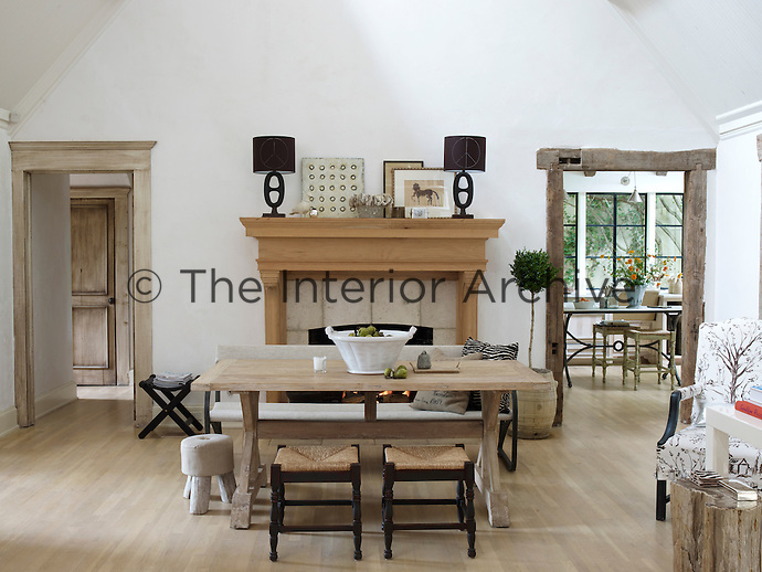 In the living room one door is framed with barn beams and the other with traditional trim