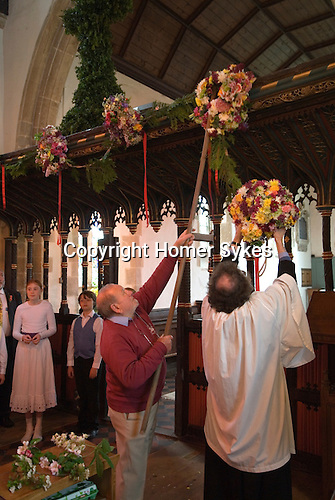 Charlton-on-Otmoor Oxfordshire May Day Celebrations. Children from the Church of England St Mary the Virgin Primary School process to the village church to have their May garlands blessed. The garlands are then hung on the church Rood Screen. 2014.