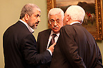 """Palestinian president Mahmud Abbas meets with Hamas chief Khaled Meshaal and other top Fatah and Hamas officials in Cairo on November 24, 2011. Abbas and Meshaal hailed a new Palestinian """"partnership"""" after talks to implement a landmark reconciliation deal. Photo by Mohammed al-Hamus"""