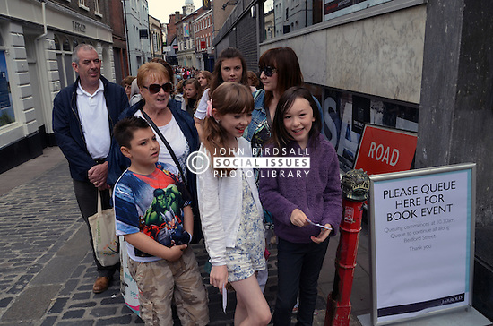 People queuing for Tanya Burr, blogger, book signing outside Jarrolds, Norwich July 2016 UK