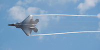 "101003-N-7981E-418 SAN DIEGO (OCTOBER 3, 2010)- A U.S. Air Force F-22 Raptor draws contrails while demonstrating the aircraft's superior maneuverability during the Marine Corps Air Station Miramar 2010 Air Show. The air show, held October 1-3, was themed ""Marines: A Tradition of Uncommon Valor"" in honor of the 65th anniversary of the Battle of Iwo Jima. (U.S. Navy photo by Mass Communication Specialist 2nd Class James R. Evans / RELEASED)"
