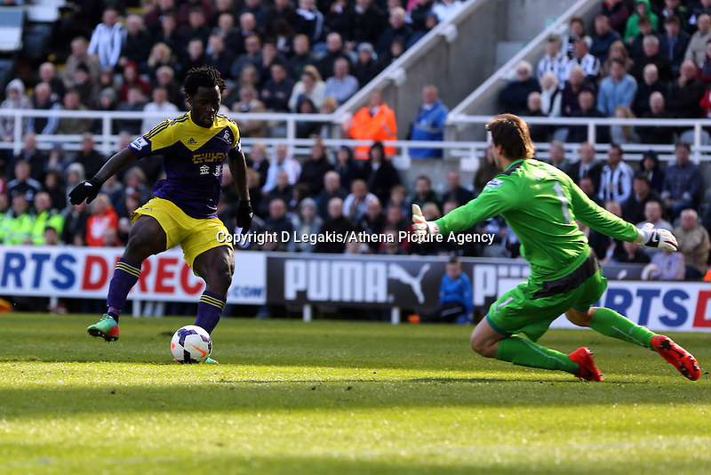 Pictured L-R: Wilfried Bony of Swansea is denied a goal by Newcastle goalkeeper Tim Krul. Saturday 19 April 2014<br /> Re: Barclay's Premier League, Newcastle United v Swansea City FC at St James Park, Newcastle, UK.