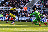 Pictured L-R: Wilfried Bony of Swansea is denied a goal by Newcastle goalkeeper Tim Krul. Saturday 19 April 2014<br />