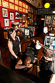 USA, California, San Diego, Bryce gets a tattoo at Master Tattoo in the Gaslamp district, the oldest tattoo shop on the west coast
