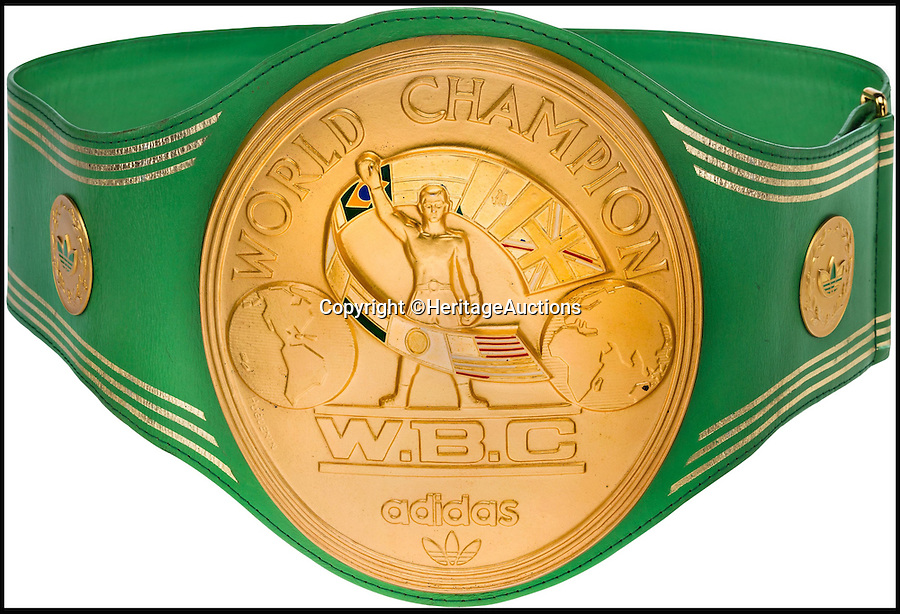 BNPS.co.uk (01202 558833)<br /> Pic: HeritageAuctions/BNPS<br /> <br /> The iconic WBC Heavyweight Championship belt won by Muhammad Ali following the legendary Rumble in the Jungle in 1974.<br /> <br /> It is being sold by Heritage Auctions in September, with experts predicting the bids could reach as high as £1 million. <br /> <br /> Also included in the sale are the white satin trunks, valued at more than £100,000, worn by the late boxer during the historic contest, as well as the gloves he used to defeat Floyd Patterson in 1972.