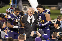 SAN FRANCISCO, CA - December 27, 2013: Gary Cavalli congratulates Washington Huskies Washington Huskies Bishop Sankey (25) and Hau'oli Kikahaand (8) the offensive and defensive players of the game for the 2013 Kraft Fight Hunger Bowl where the  the BYU Cougars at AT&T Park in San Francisco, California. Final score Washington Huskies 31, BYU Cougars 16.