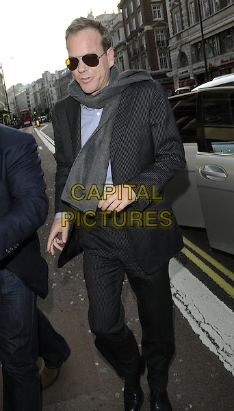 "KIEFER SUTHERLAND.Arrives to ""An Evening With Kiefer Sutherland"" Q & A Event, BAFTA Piccadilly, London, England, UK, April 16th 2010..full length sunglasses grey gray suit pinstripe scarf walking black .CAP/CAN.©Can Nguyen/Capital Pictures."