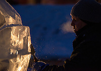 """Chris Berryhill chips away at his sculpture of a squirrel titled """"I Want Your Birdseed"""" on the final morning of the 2016 """"Crystal Gallery of Ice"""" Ice Carving Competition in town square."""