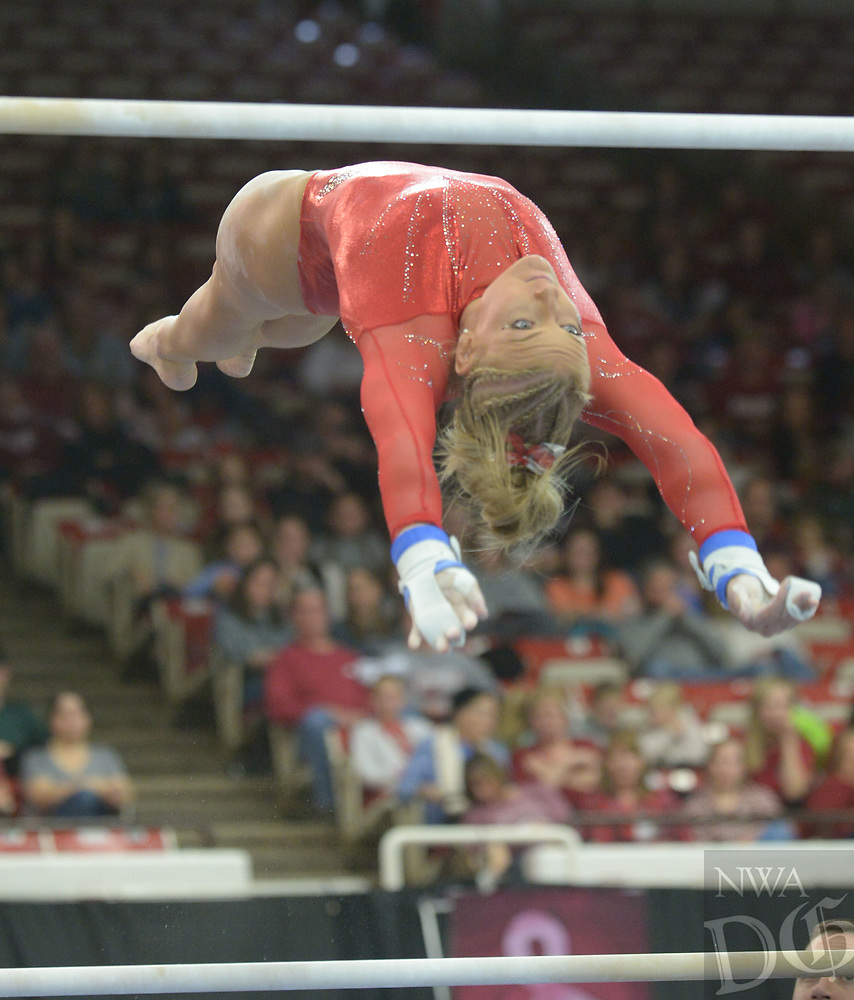 NWA Democrat-Gazette/ANDY SHUPE<br /> Arkansas' Sarah Shaffer competes in the bars Saturday, Jan. 5, 2019, during the Razorbacks' meet with No. 2 Oklahoma in Barnhill Arena in Fayetteville. Visit nwadg.com/photos to see more photographs from the meet.