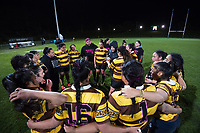 The Porirua team huddles at halftime during the 2019 Wellington secondary schools girls 1st XV rugby final between Porirua/Aotea College (combined) and Hutt Valley High School at Porirua Park in Wellington, New Zealand on Wednesday, 21 August 2019. Photo: Dave Lintott / lintottphoto.co.nz