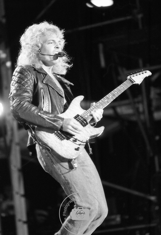 Peter frampton performing with David Bowie 1987.