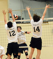 WARMINSTER, PA - APRIL 23:  Council Rock North's Will Deseutelle #24 hits the ball across the net as William Tennent's Nick Makell #12 and Josh Ferguson #14 defend during the first half at William Tennent April 23, 2014 in Warminster, Pennsylvania.  (Photo by William Thomas Cain/Cain Images)
