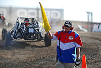 Dec. 10, 2010; Chandler, AZ, USA;  A LOORRS official directs drivers out to the track during qualifying for round 15 at Firebird International Raceway. Mandatory Credit: Mark J. Rebilas-US PRESSWIRE