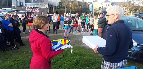 Stephanie Hannan is presented with a Cumann Seoltóireachta an Spidéil flag by commodore Dave Cahill after the CSS 2020 regatta on September 19th, 2020