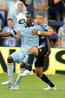C.J Sapong (blue) Sporting KC forward holds off the challenge ofJason Hernandez San Jose Earthquakes defender... Sporting KC defeated San Jose Earthquakes 1-0 at LIVESTRONG Sporting Park, Kansas City, Kansas.
