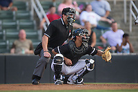 Kannapolis Intimidators catcher Seby Zavala (21) sets a target as home plate umpire Jason Johnson looks on during the game against the Delmarva Shorebirds at Kannapolis Intimidators Stadium on June 23, 2016 in Kannapolis, North Carolina.  The game was suspended in the bottom of the 4th inning due to rain.  (Brian Westerholt/Four Seam Images)