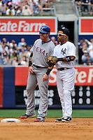 New York Yankees infielder Robinson Cano #24 and Texas Rangers base runner Josh Hamilton #32 during game played at Yankee Stadium on June 16, 2011 in Bronx, NY.  Yankees defeated Rangers 3-2.  Tomasso DeRosa/Four Seam Images