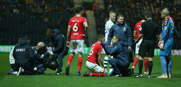 Preston North End's Louis Moult and Middlesbrough's Lewis Wing lie injured after clashing heading the ball<br /> <br /> Photographer Stephen White/CameraSport<br /> <br /> The EFL Sky Bet Championship - Preston North End v Middlesbrough - Tuesday 27th November 2018 - Deepdale Stadium - Preston<br /> <br /> World Copyright © 2018 CameraSport. All rights reserved. 43 Linden Ave. Countesthorpe. Leicester. England. LE8 5PG - Tel: +44 (0) 116 277 4147 - admin@camerasport.com - www.camerasport.com