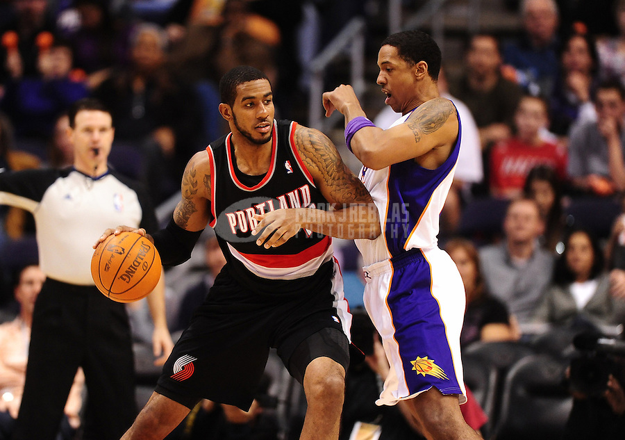Jan. 6, 2012; Phoenix, AZ, USA; Portland Trail Blazers forward LaMarcus Aldridge (left) drives to the basket against Phoenix Suns center Channing Frye at the US Airways Center. The Suns defeated the Trail Blazers 102-77. Mandatory Credit: Mark J. Rebilas-.