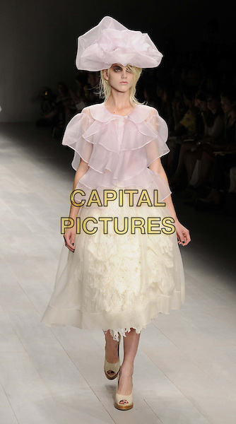 model on the catwalk.at the John Rocha s/s 2013 catwalk show, LFW Day 2, Courtyard Show Space, Somerset House, The Strand, London, England, UK, .15th September 2012..full length runway modeling ruffles white pink top hat skirt .CAP/CAN.©Can Nguyen/Capital Pictures.
