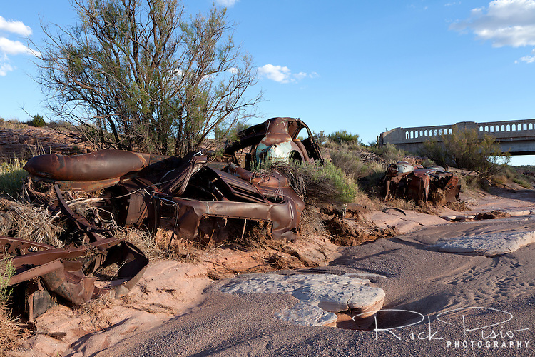 Rusted auto and pickup trucks line the bank of the Dead Wash in Arizona along an abandoned alignment of Route 66.