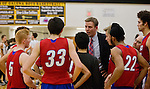 Reno coach Matt Ochs talks with his team during a time out against Galena in their Northern Region Division I boys basketball game played at Galena High School on Tuesday night, Feb. 17, 2015.