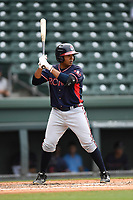 Catcher Carlos Martinez (4) of the Rome Braves bats in game one of a doubleheader against the Greenville Drive on Tuesday, May 30, 2017, at Fluor Field at the West End in Greenville, South Carolina. Rome won, 10-7. (Tom Priddy/Four Seam Images)